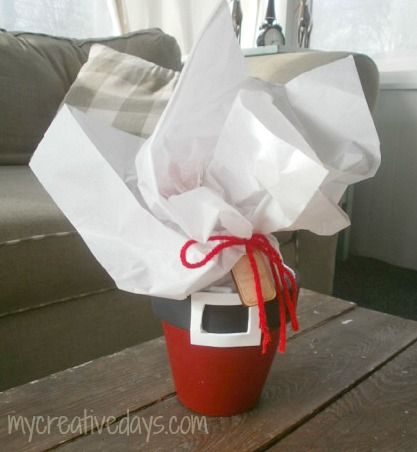 Use terra cotta pots in a cute holiday DIY. The thick border becomes Santa's famous belt an the opening is just enough to stuff with gifts for neighbors or teachers.