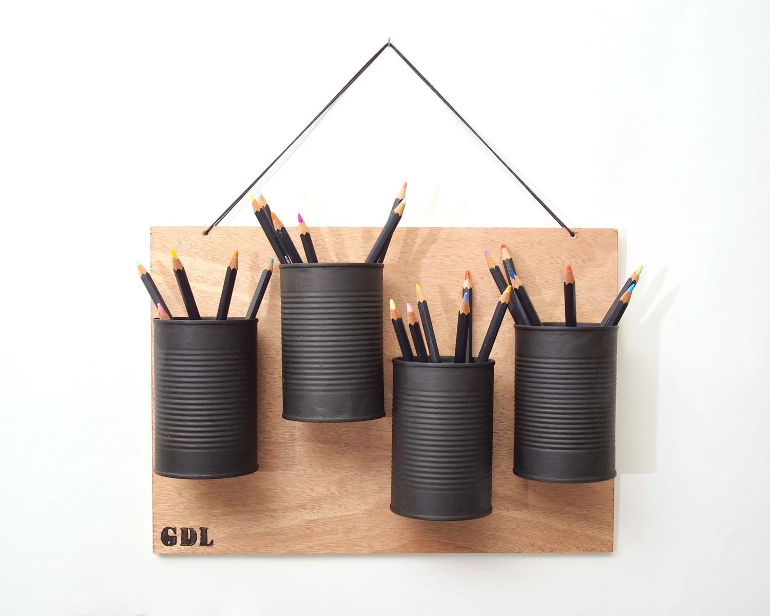 recycled hanging pencil holder - recycled wood and tin cans