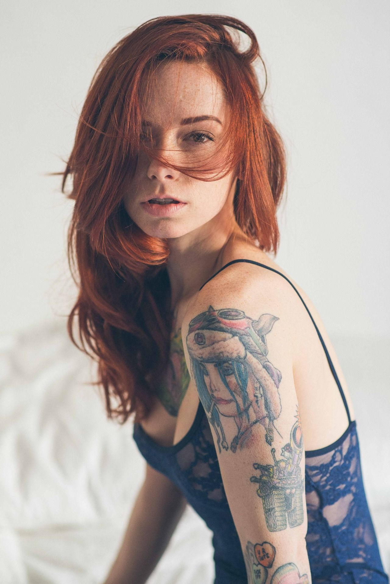 Redhead with tattoos solo