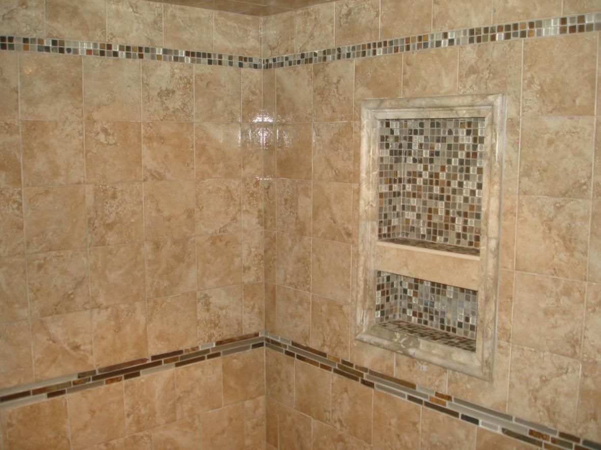 Glass tile mosaic shower niche and accent border shower