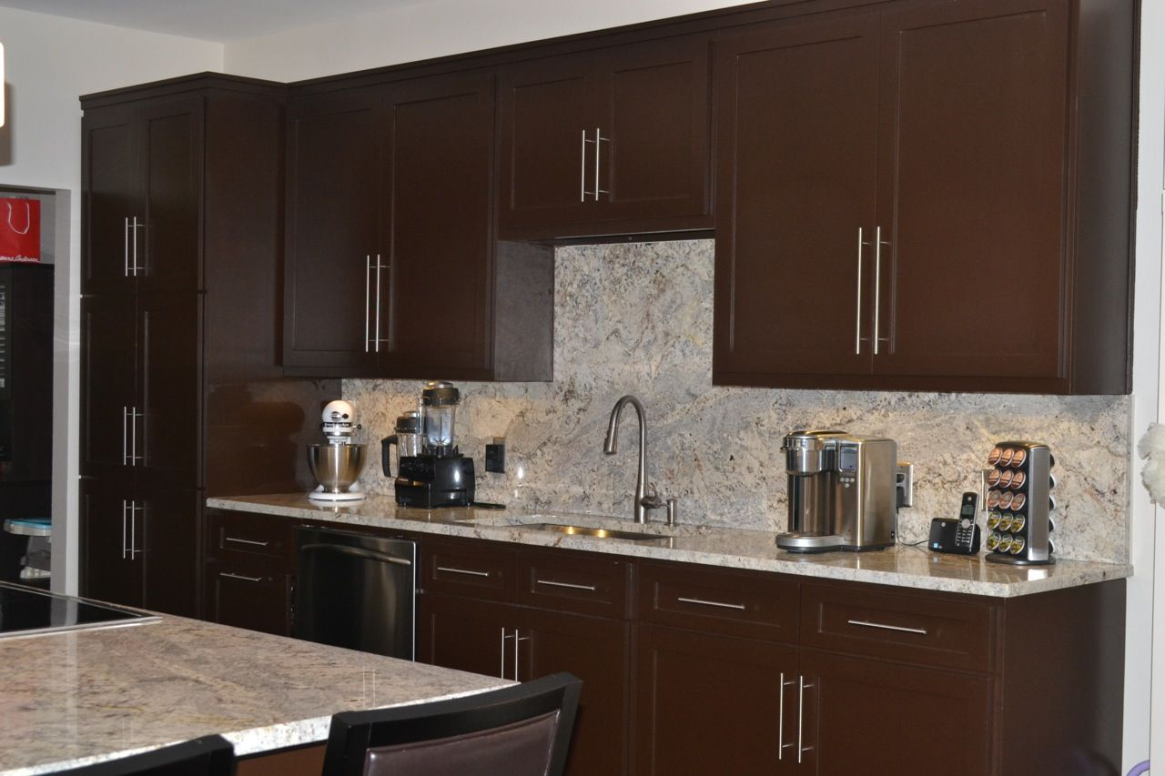 Wall area features custom maple cabinetry including for Sherwin williams cabinet paint