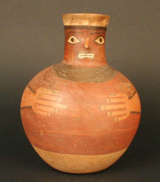 TIWANAKU < 6 de 11> Jarro antropomorfo Features Materials: Ceramic Periodo: Medio 700- 1100 d.C. Measures: 173 mm de alto Part Code: MCHAP 2822 See Tiwanaku culture Horizonte Wari-Tiwanaku.