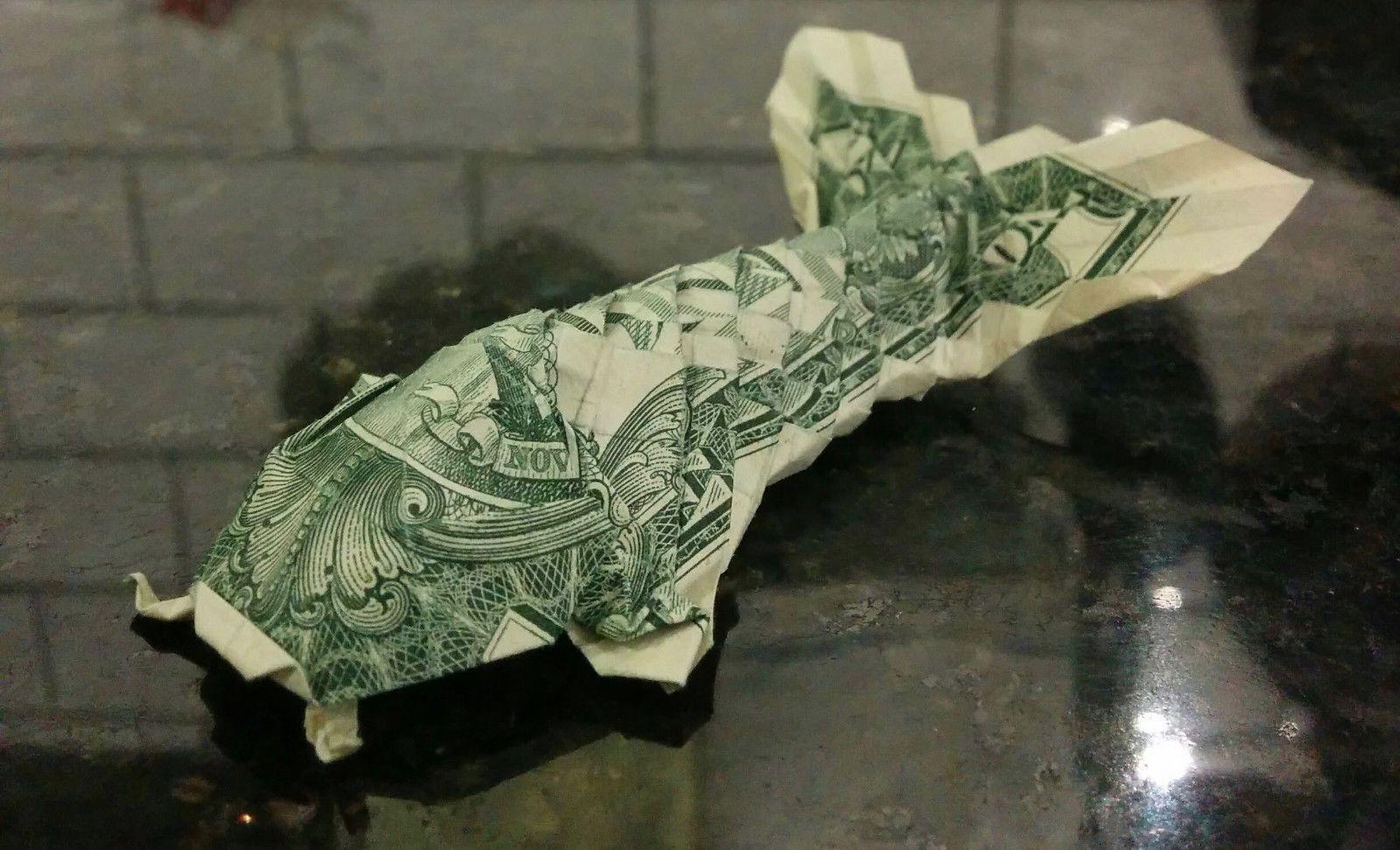 Money origami koi fish made with us 1 dollar bill common money origami koi fish made with us 1 dollar bill jeuxipadfo Choice Image