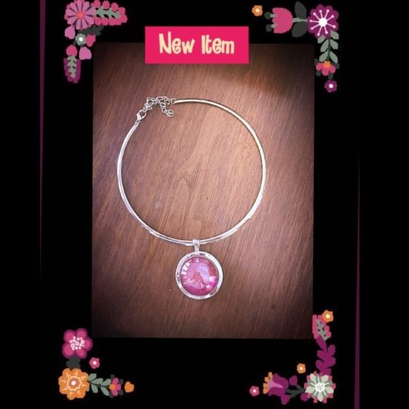 Silver choker with purple glass pendant New with out tags... This choker is adjustable for the perfect fit. The purple glass gem in the middle is almost iridescent! The slide can come off of the choker and can be worn by itself or you can add other slides to it. Great, versatile, piece! Jewelry Necklaces