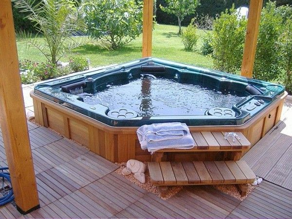 How Much Does It Cost To Run A Hot Tub Pool University Jacuzzi Hot Tub Hot Tub Outdoor Sunken Hot Tub