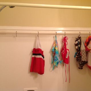 Awesome idea for hanging wet garments (swimsuits, towels, hand washables, etc...) in the bathtub to dry using a shower curtain tension rod and hooks.