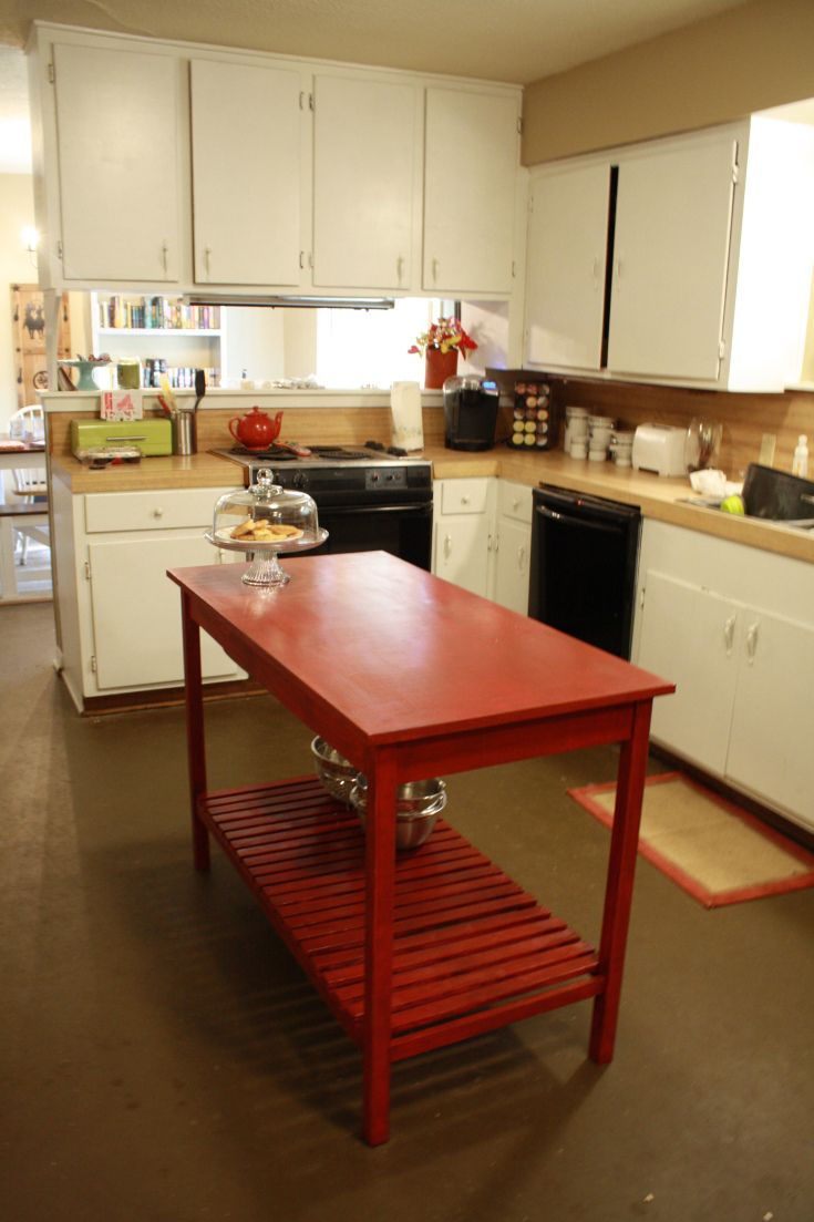 Appealing cherry wood small kitchen islands with red painted and single tier shelves combined with white kitchen cabinets in modern kitchen designs