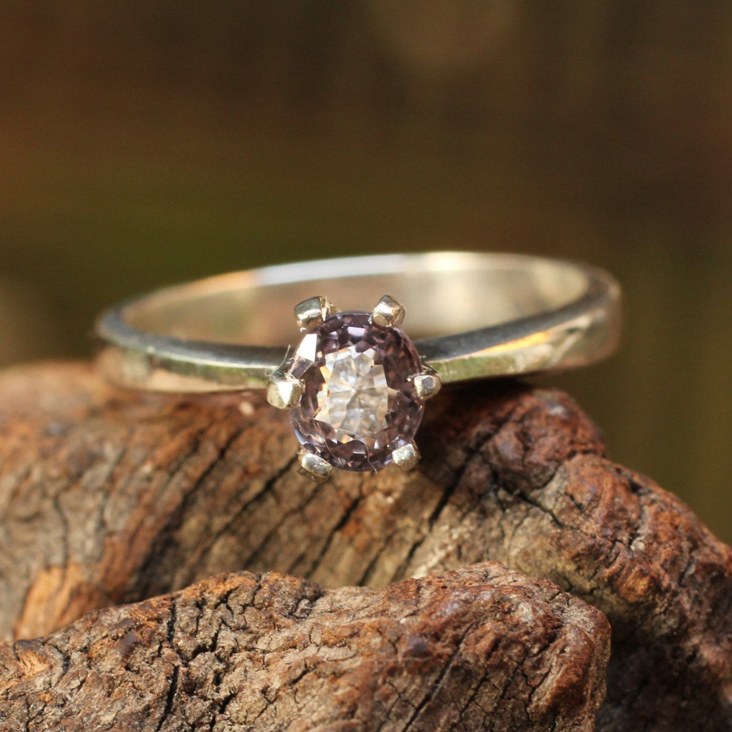 Sterling silver ring with faceted purple spinal gemstone