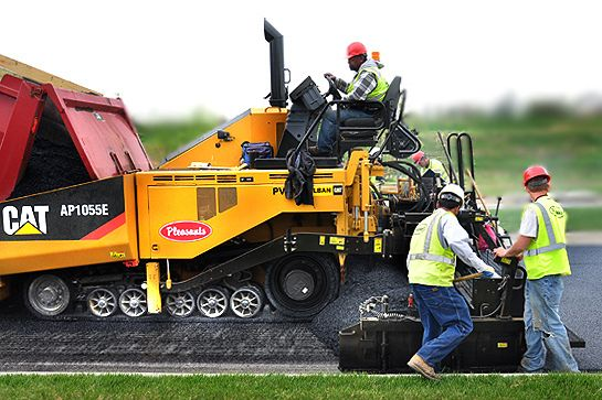 A paving machine and crew place hot asphalt along Potomac View Parkway at Brunswick Crossing, a planned community in Brunswick, Maryland by Brunswick Crossing, via Flickr