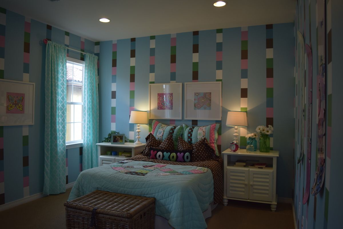 This pink and blue room will be a fun escape for the little girl in your family with plenty of room for playing pretend.
