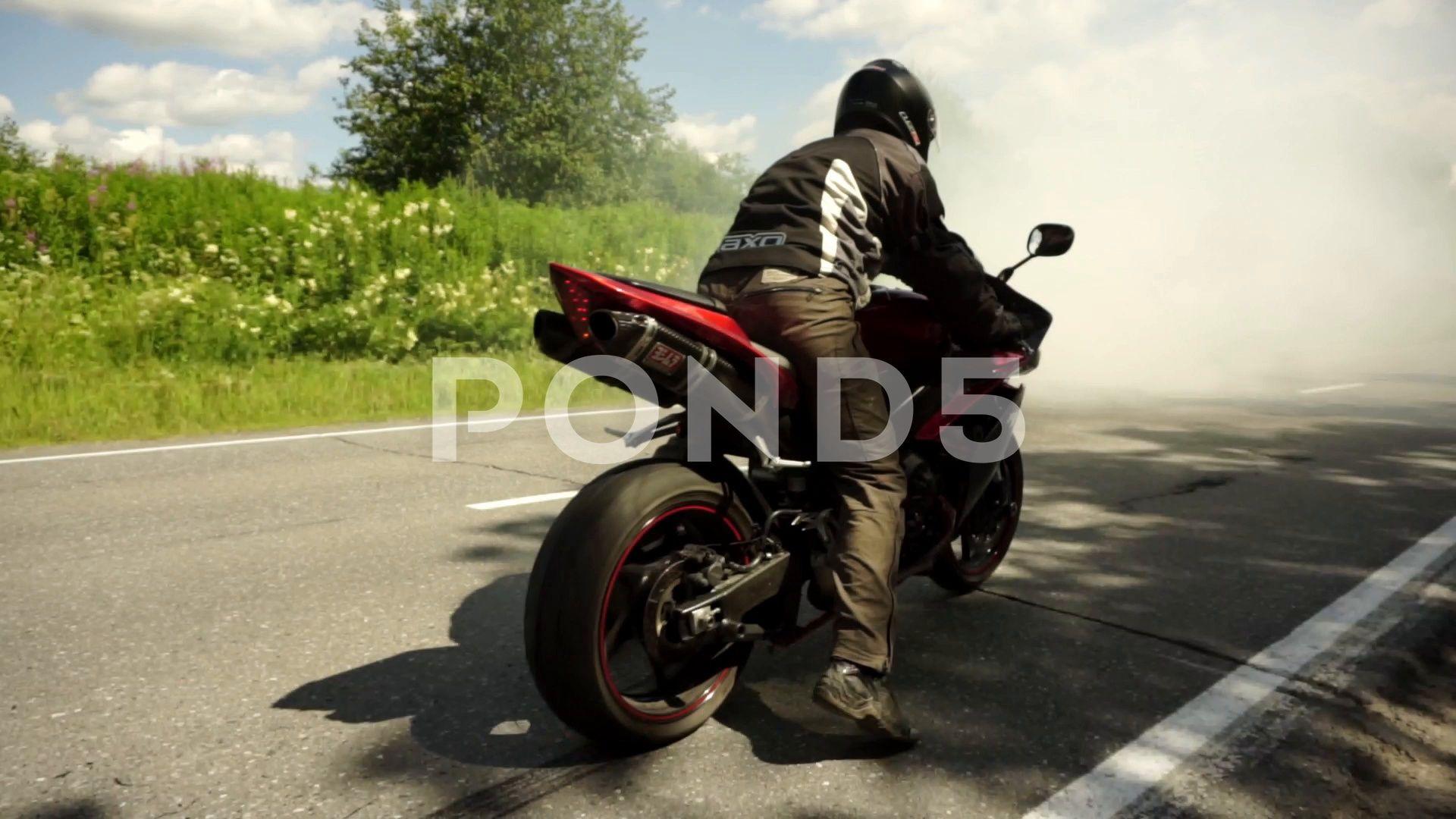 Professional Motocross Fmx Motorcycle Rider Drives Through Smoke