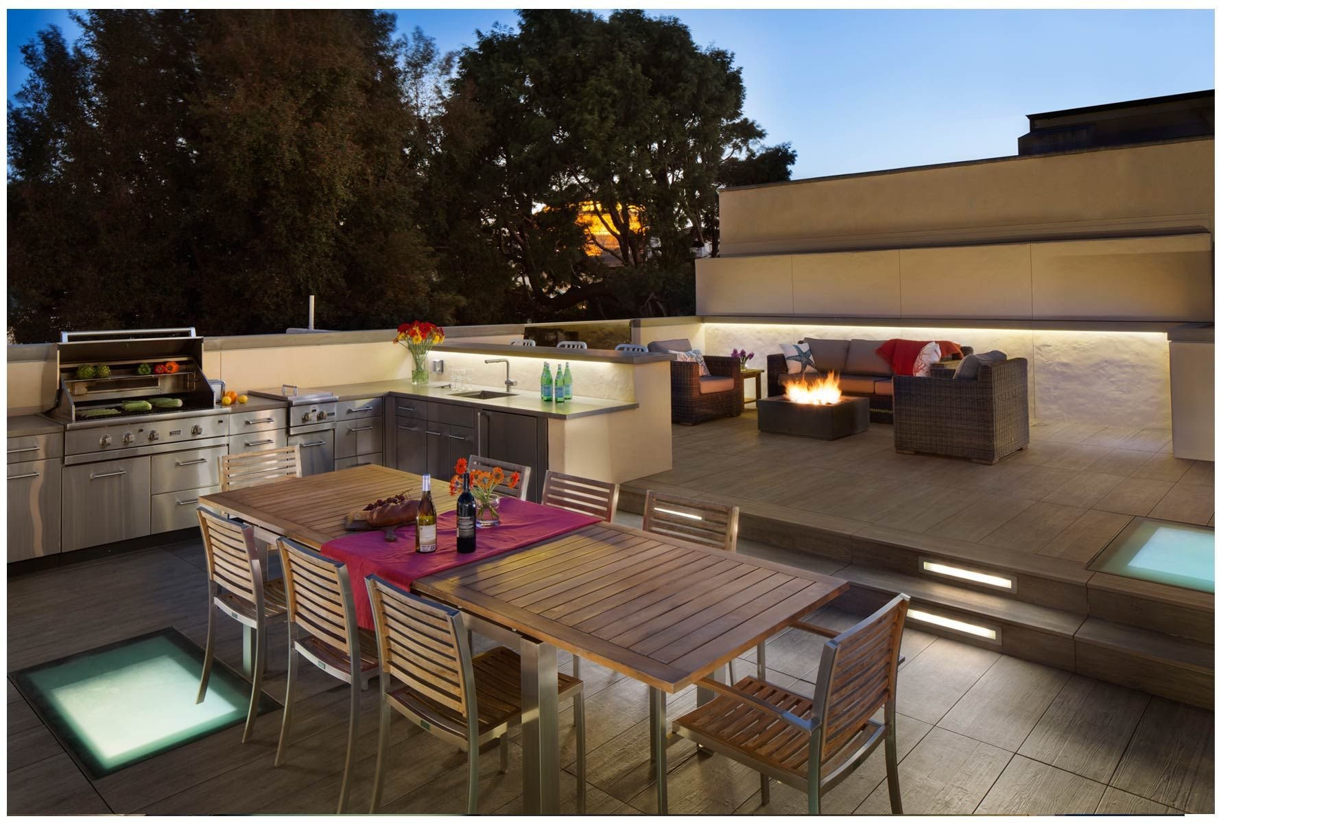 This roof deck renovation includes an outdoor kitchen fire pit