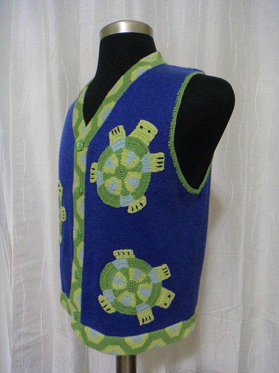 A turtle vest? Why not! Or maybe these cuties are sea tortoises floating on this vest in a sea of blue. The turtles are crocheted and added on to the