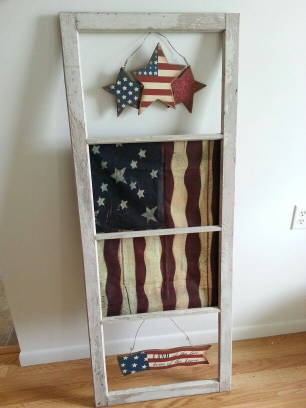 Hubby and I made this out of and old window, flag and a sign from Hobby Lobby total cost $18.00