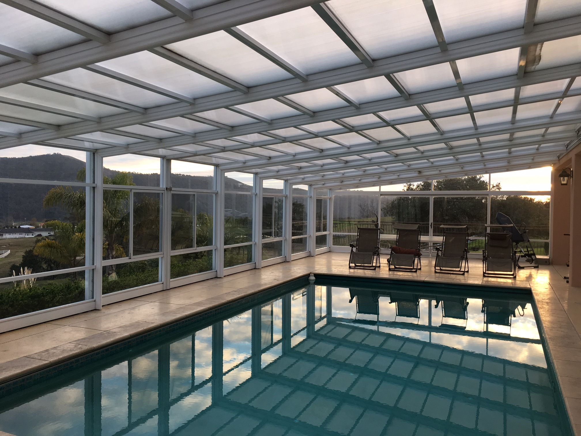Retractable Pool Enclosures Manufactured By Roll A Cover Swimming Pool Enclosures Pool Enclosures Outdoor Patio Space