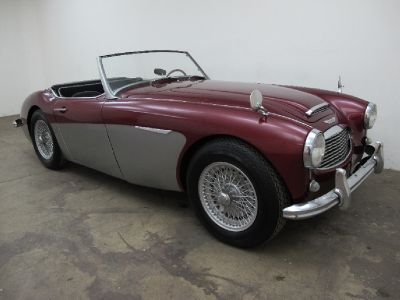 1957 austin healey 100 6 convertible sports car in maroon with grey coves with black interior. Black Bedroom Furniture Sets. Home Design Ideas