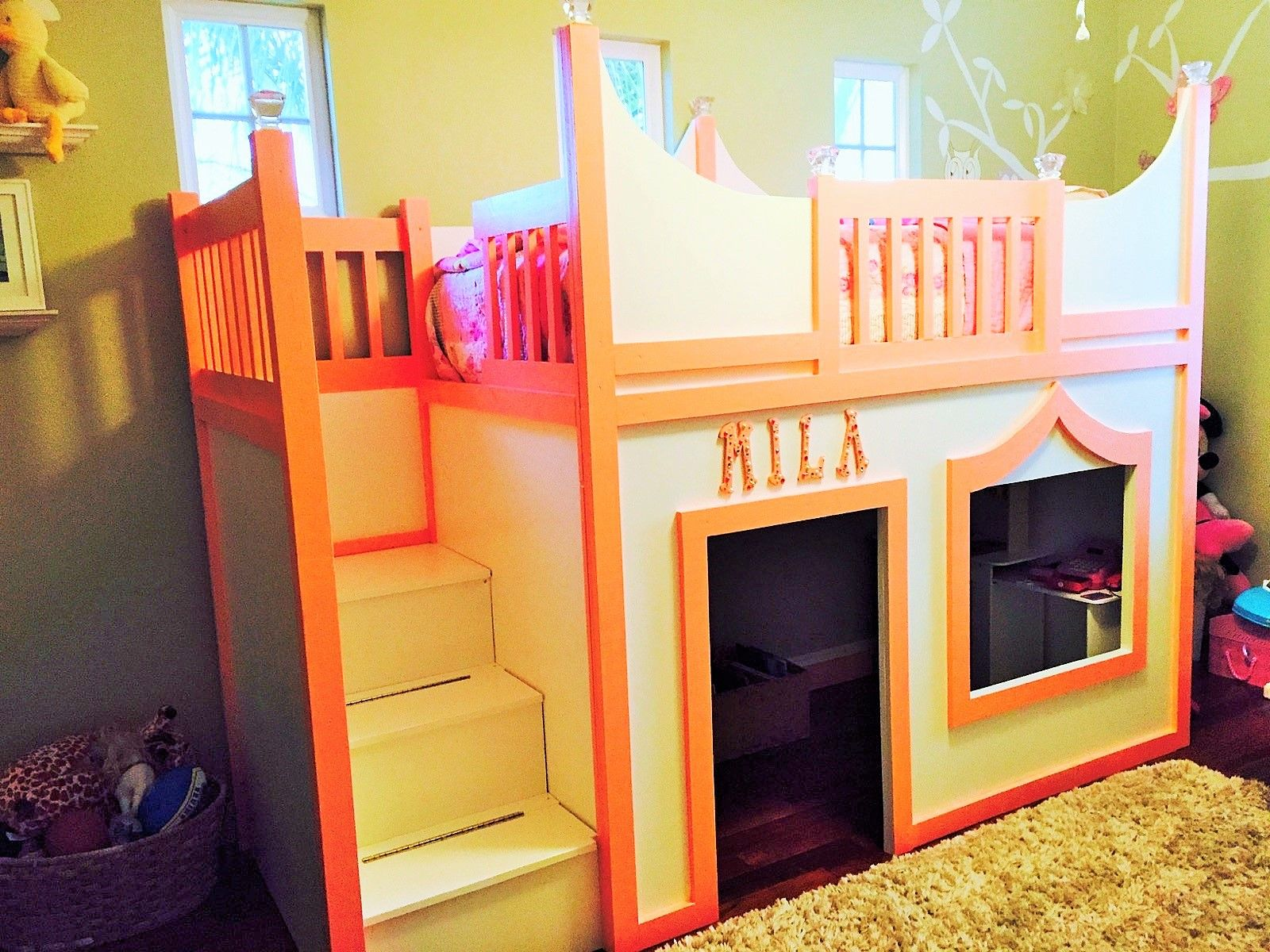 Princess playhouse loft bed with storage stairs and additional storage accessed from playhouse