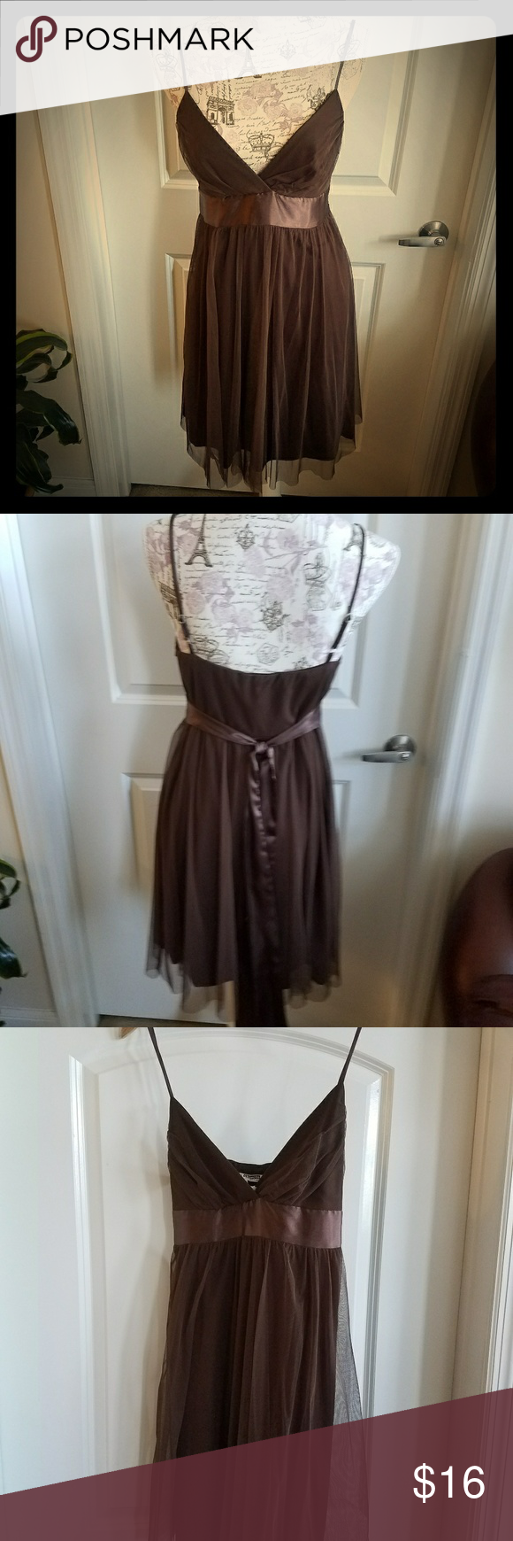 Necessary objects Cocoa Brown dress This comfortable worn Cocoa Brown dress has a satin ribbon that ties across to the back. This has a nylon lining, side zip and adjustable straps. I feel this run a little small if your busty.  Hand wash Necessary Objects Dresses Midi