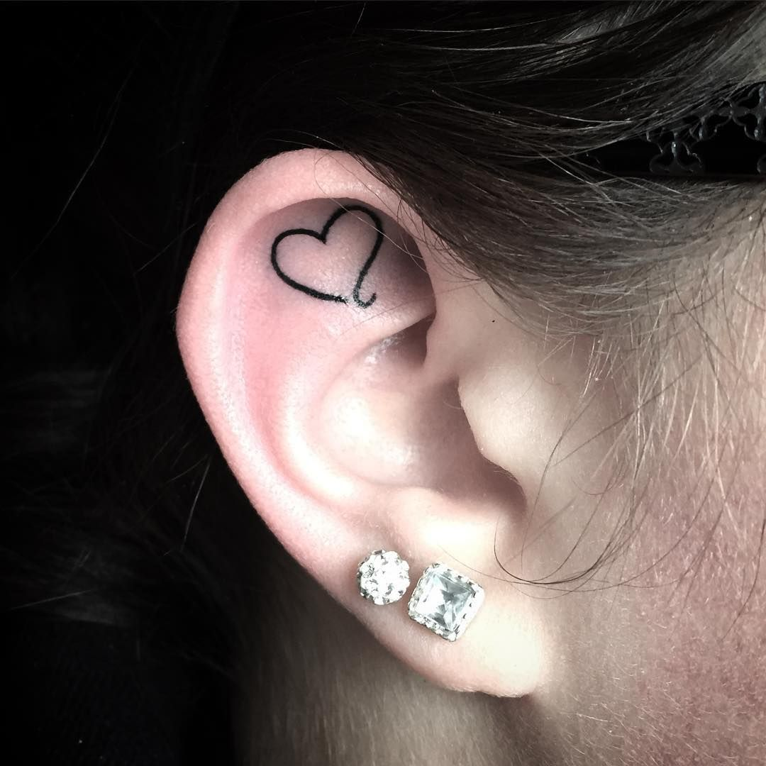Nose piercing through the middle   Ear Tattoo Ideas That Are Whispering For Your Attention  Tattoo