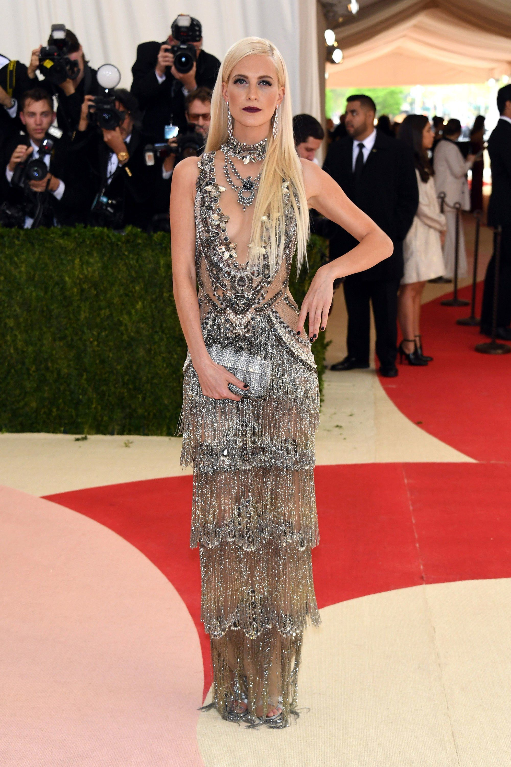 Poppy Delevingne in a Marchesa dress, Stephen Webster earrings, Oroton bag, and Giuseppe Zanotti shoes