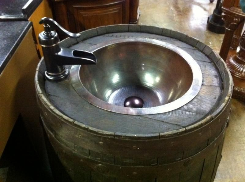 Never did get around to making a whiskey barrel sink but for Whiskey barrel bathtub