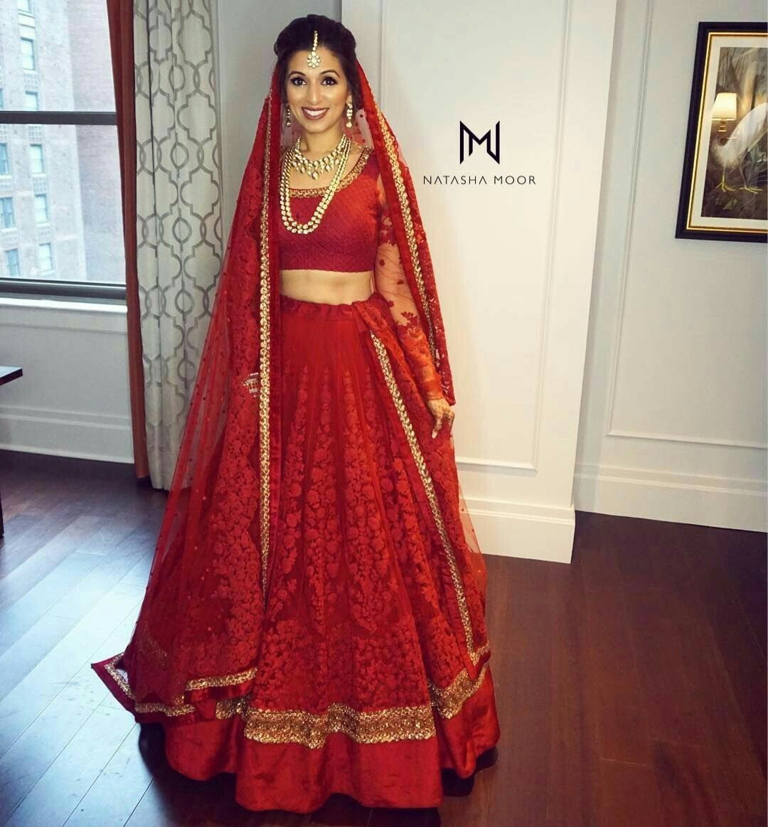 Indian bride wearing bridal lehenga. Bridal makeup. Bridal ...