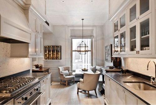 Super chic creamy greige galley kitchen by Suzanne Kasler.