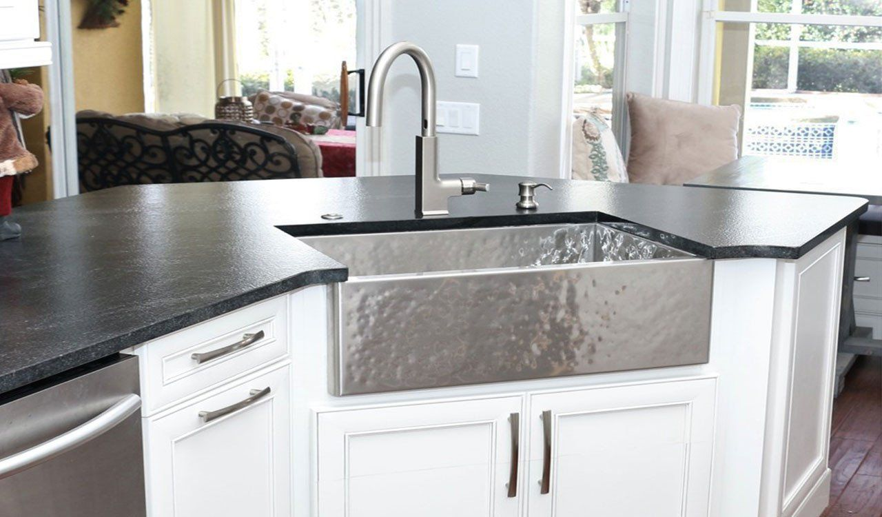 Hammered Stainless Steel Farmhouse Sink In A Luxury Kitchen Built