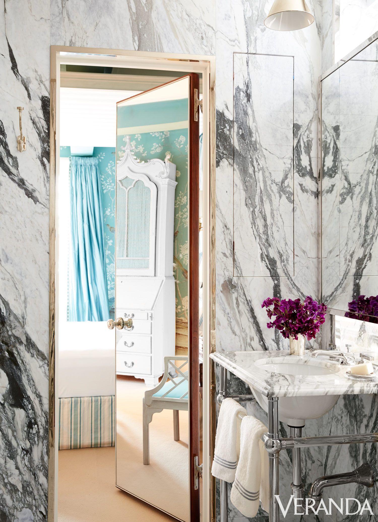 Marble walls and countertops add sophistication to the new york city bathroom manhattan apartment also veranda magazine verandamag on pinterest rh