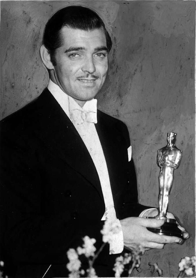 """Clark Gable poses with his best actor Oscar for """"It Happened One Night"""" at  the Oscar ceremony on Feb. 27, 1935 