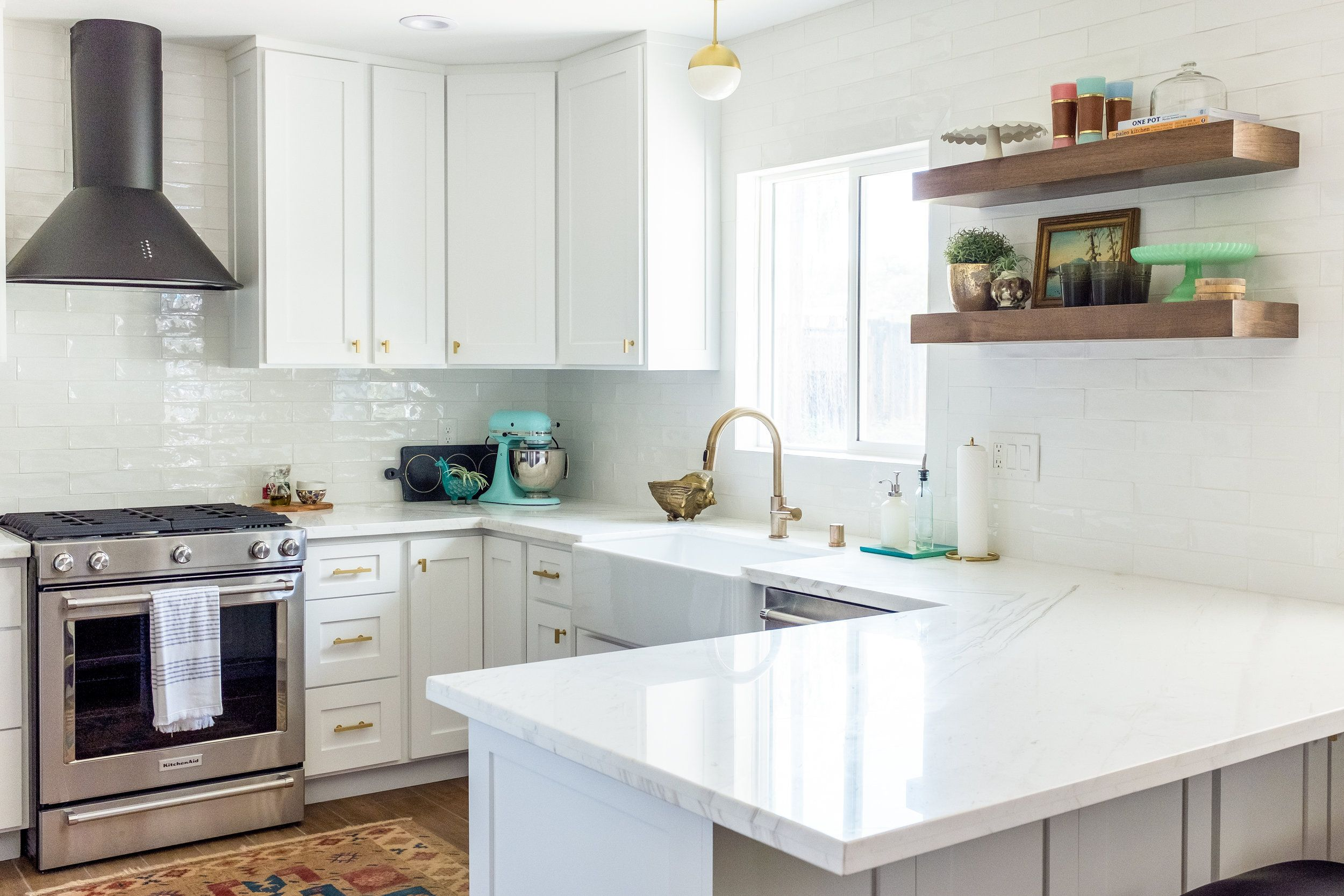 White classic kitchen with shaker cabinets, marble counters and ...