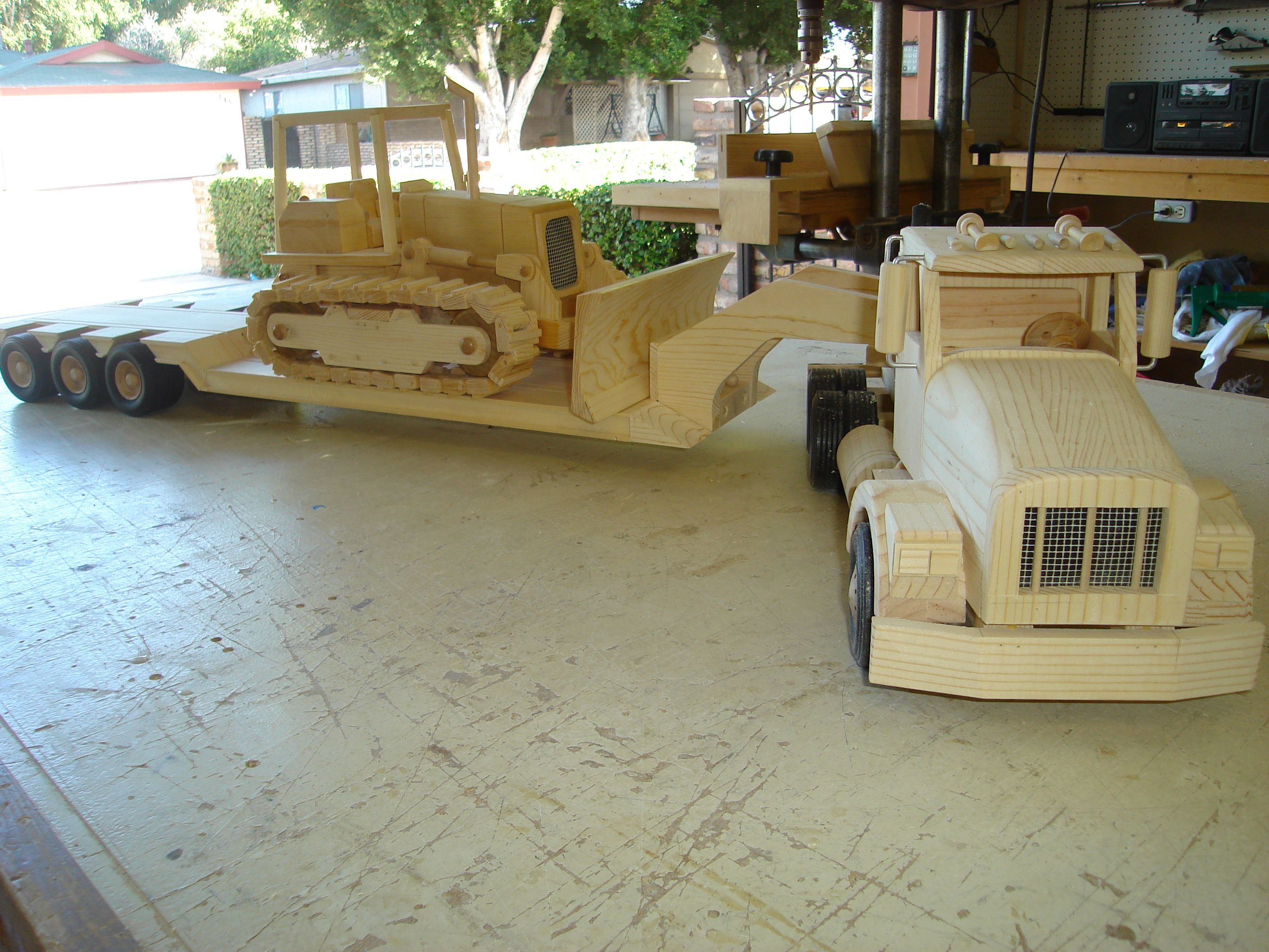 Frontal and side view of truck and trailer with Dozer making a turn ...