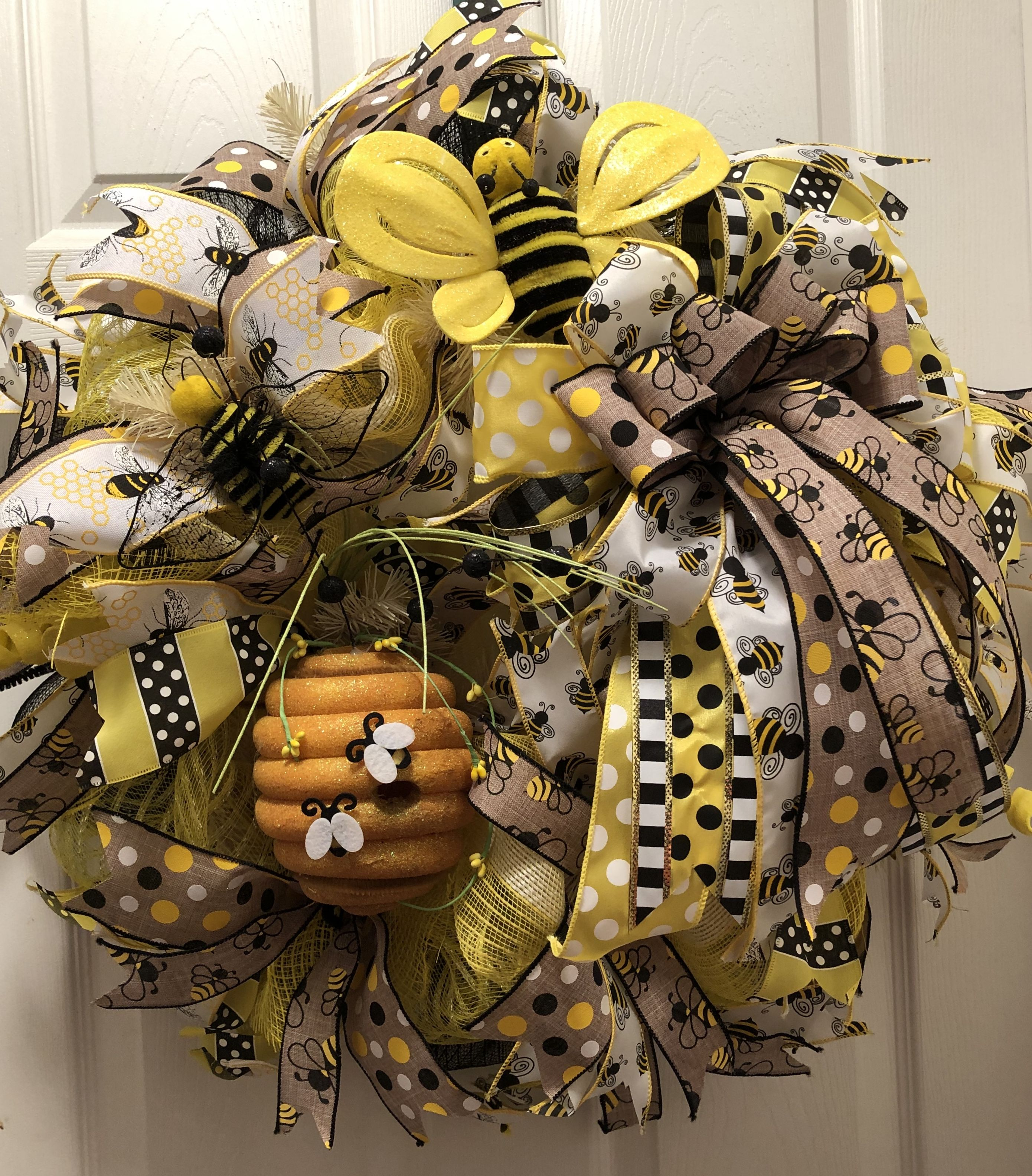Bee hive on wire wreath form Bees deco mesh and ribbons in