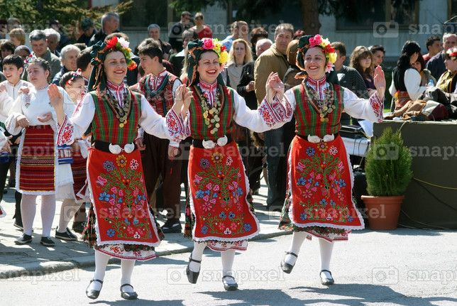 bulgaria women during traditional dance wearing costume