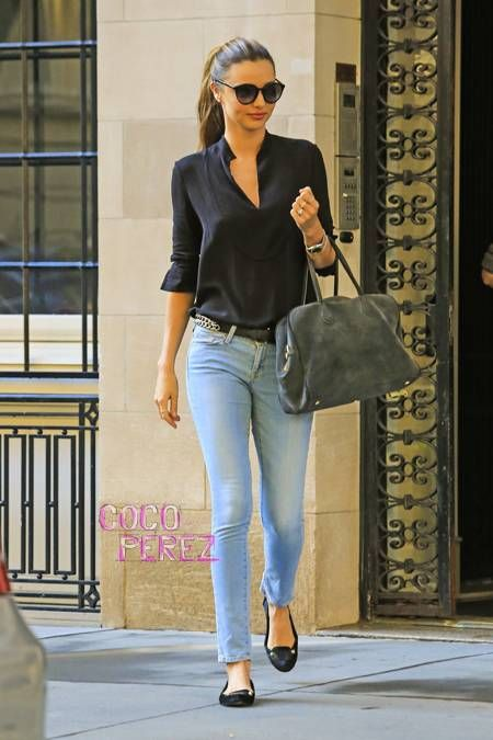 Miranda Kerr ventures through NYC in a casual jeans and an easy blouse outfit.