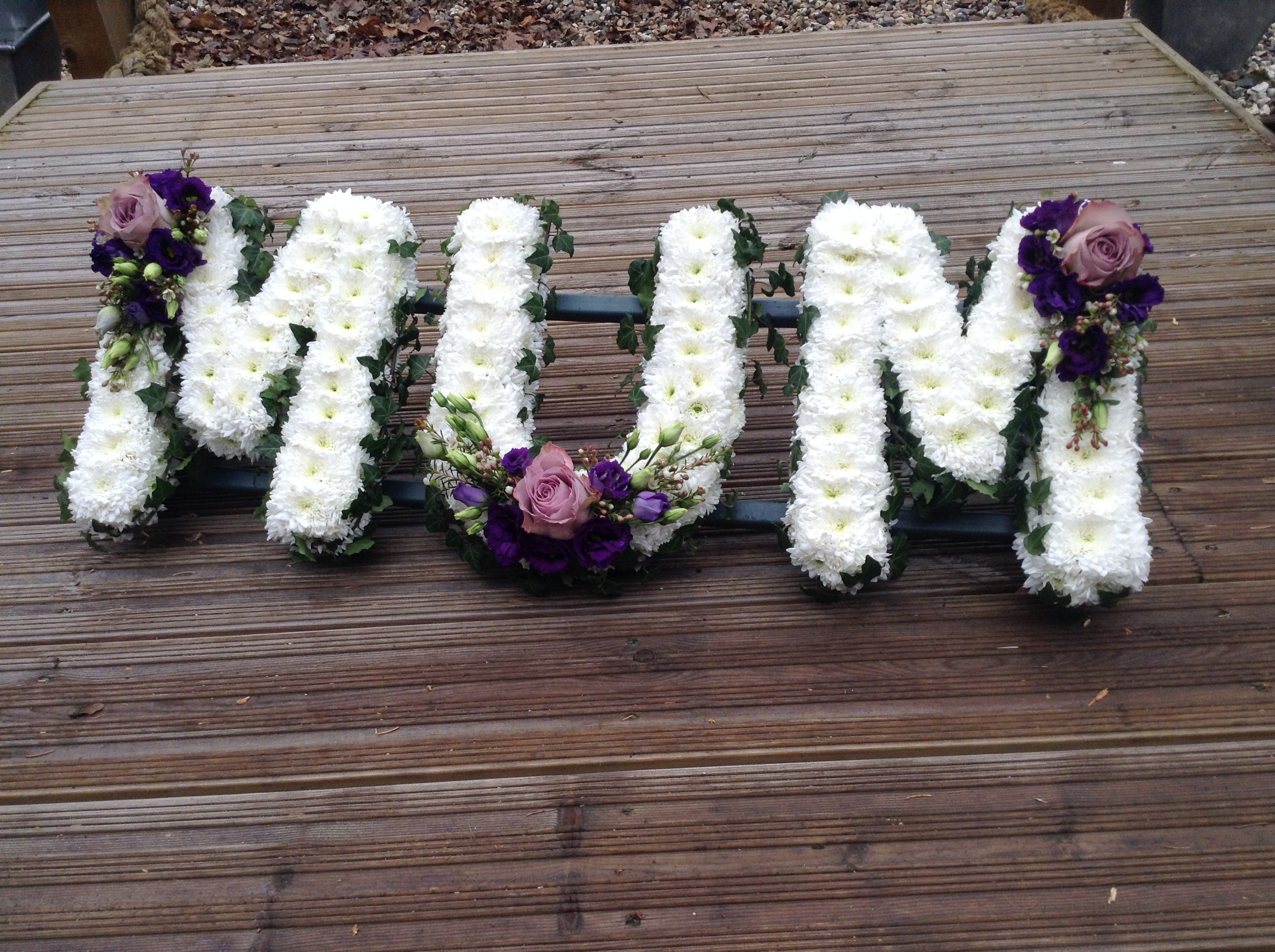 Mum Funeral Flower Letter Tribute With Ivy Edging And Lilac Sprays