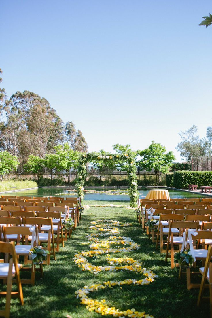 Outdoor wedding ceremony with yellow petals #aisle #gardenwedding #ceremony #weddingceremony #outdoorwedding