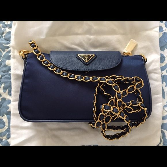 Prada Nylon Tessuto Saffiano Clutch Sling Bag This Prada clutch sling bag  in royal blue features be7919584e65d
