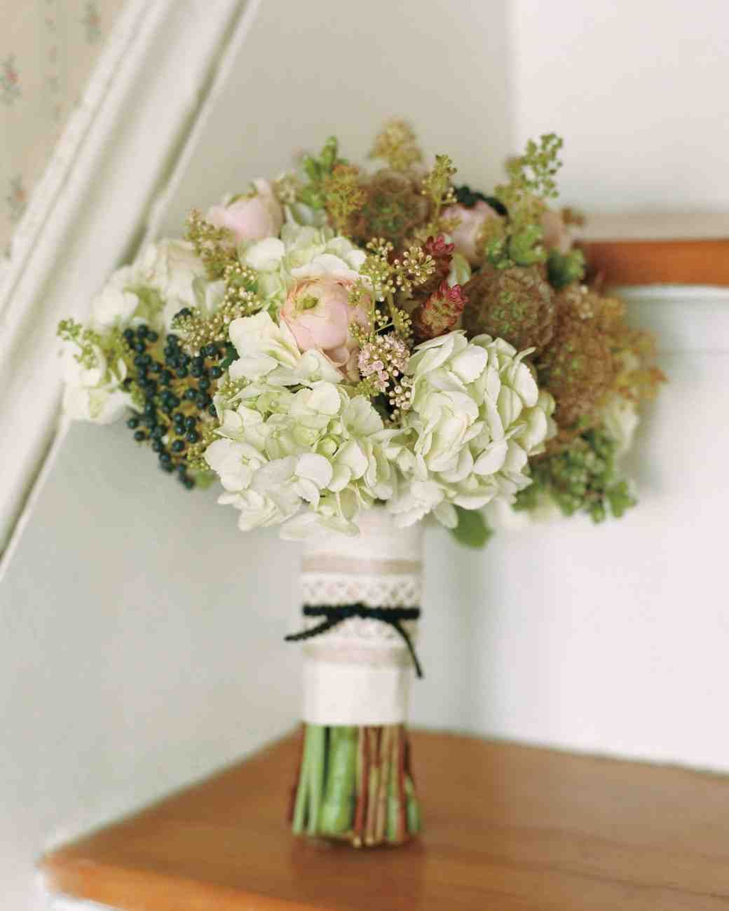 38 Ideas for Your Bridesmaids' Bouquets | Martha Stewart Weddings - At this couple's nuptials in Maine, each bridesmaid carried a dense cluster of privet berries, hydrangea, ranunculus, scabiosa, and oregano, along with a few wild blooms from the region from Mindy Rice Design.