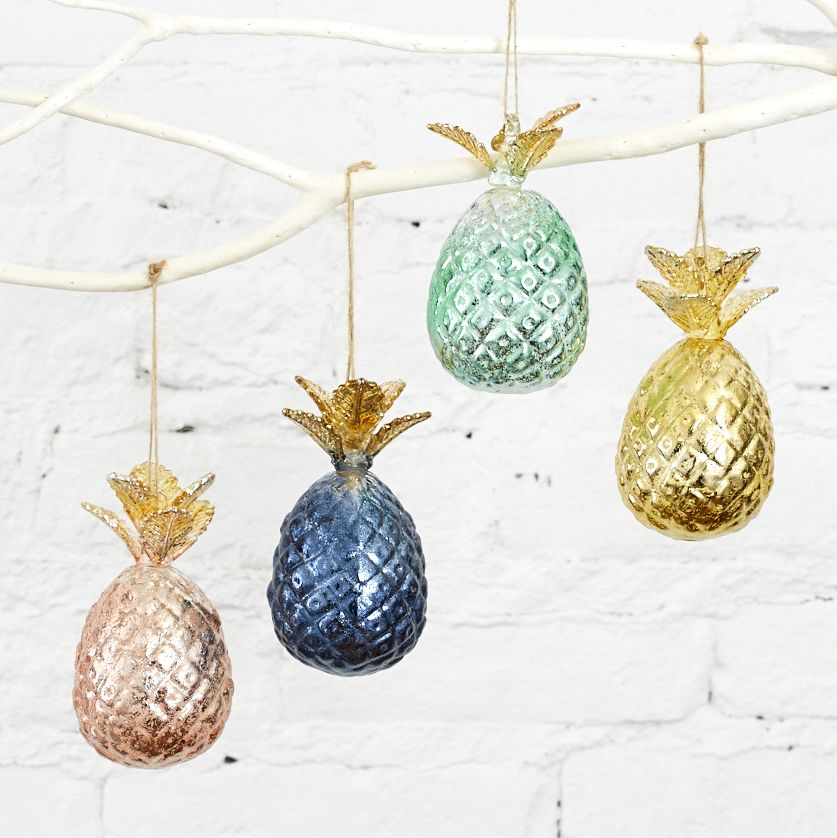 show off your pineapple love with these gilded ornaments