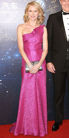 Last Night's Look: Love It or Leave It? Vote Now!   NAOMI WATTS   The actress goes with a super feminine look for the 15th Huading Awards in Macau, China. She pairs a fuchsia Roland Mouret gown with sparkling Bulgari jewels and a silver clutch.