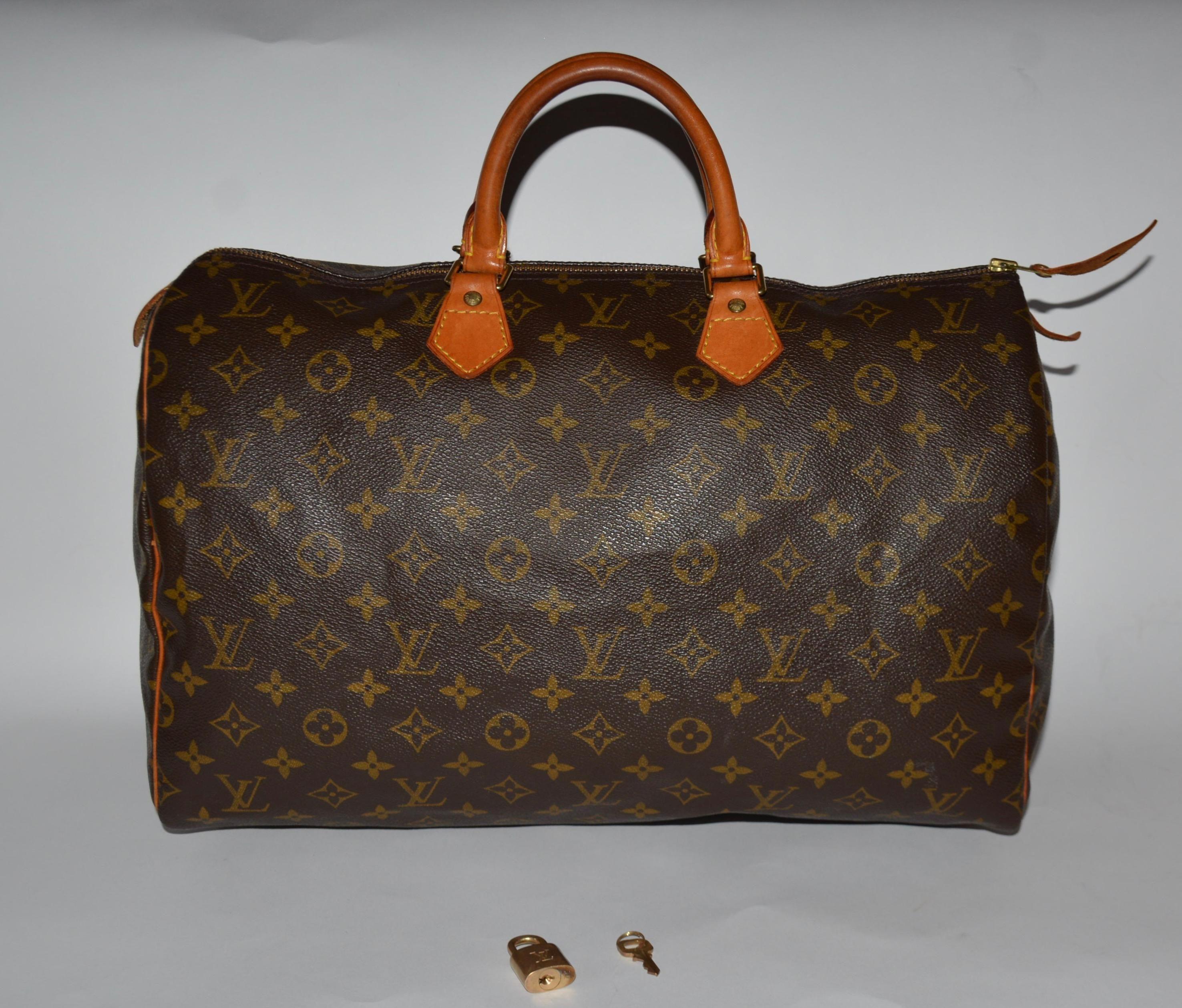 08f45fddbf85 Louis Vuitton Monogram Canvas Speedy 40 Brown Satchel. Save 66% on the Louis  Vuitton Monogram Canvas Speedy 40 Brown Satchel!