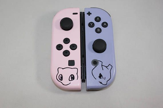 Custom Pair Of Nintendo Switch Joy Cons Featuring The Color Scheme And Likeness Of Pokemon Mew And M Nintendo Switch Accessories Nintendo Switch Mew And Mewtwo