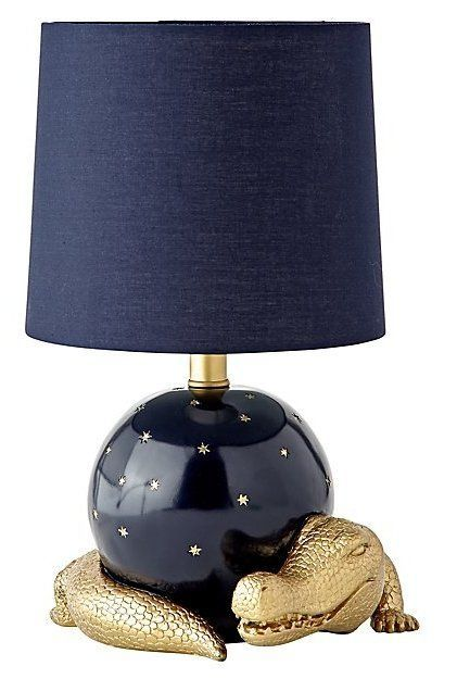 Theres nothing ordinary about this statement making table lamp it theres nothing ordinary about this statement making table lamp it features a blue base and shade gold star detailing and one rather unexpected a aloadofball Gallery
