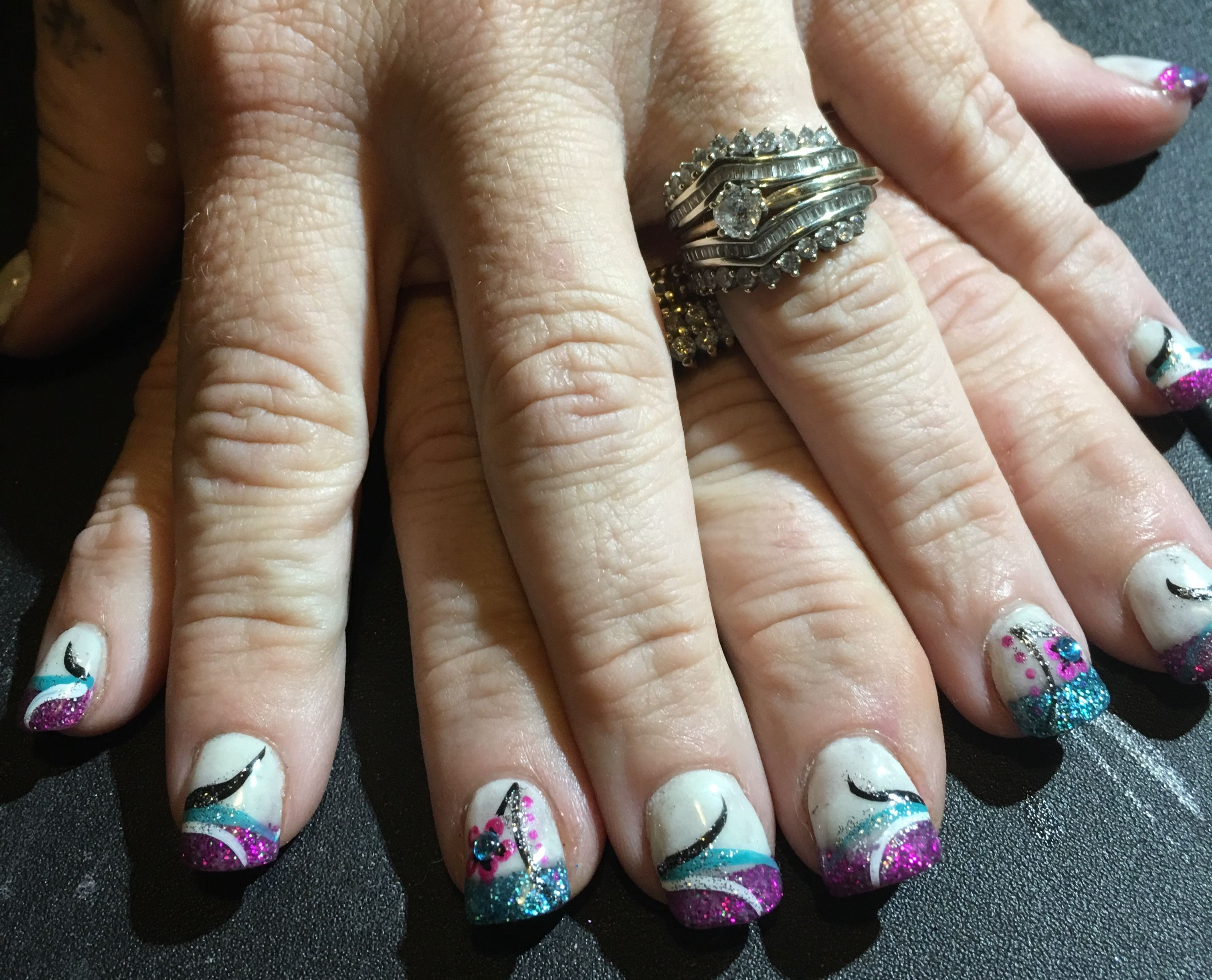 Glow in the dark nail beds with teal and pink acrylic glitter. Free ...