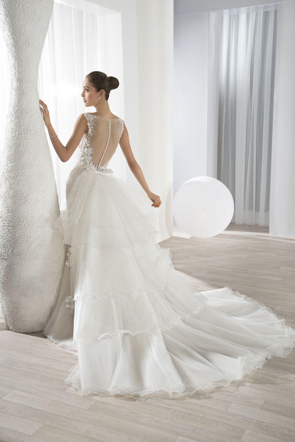 Formfitting lace gown with illusion back and button