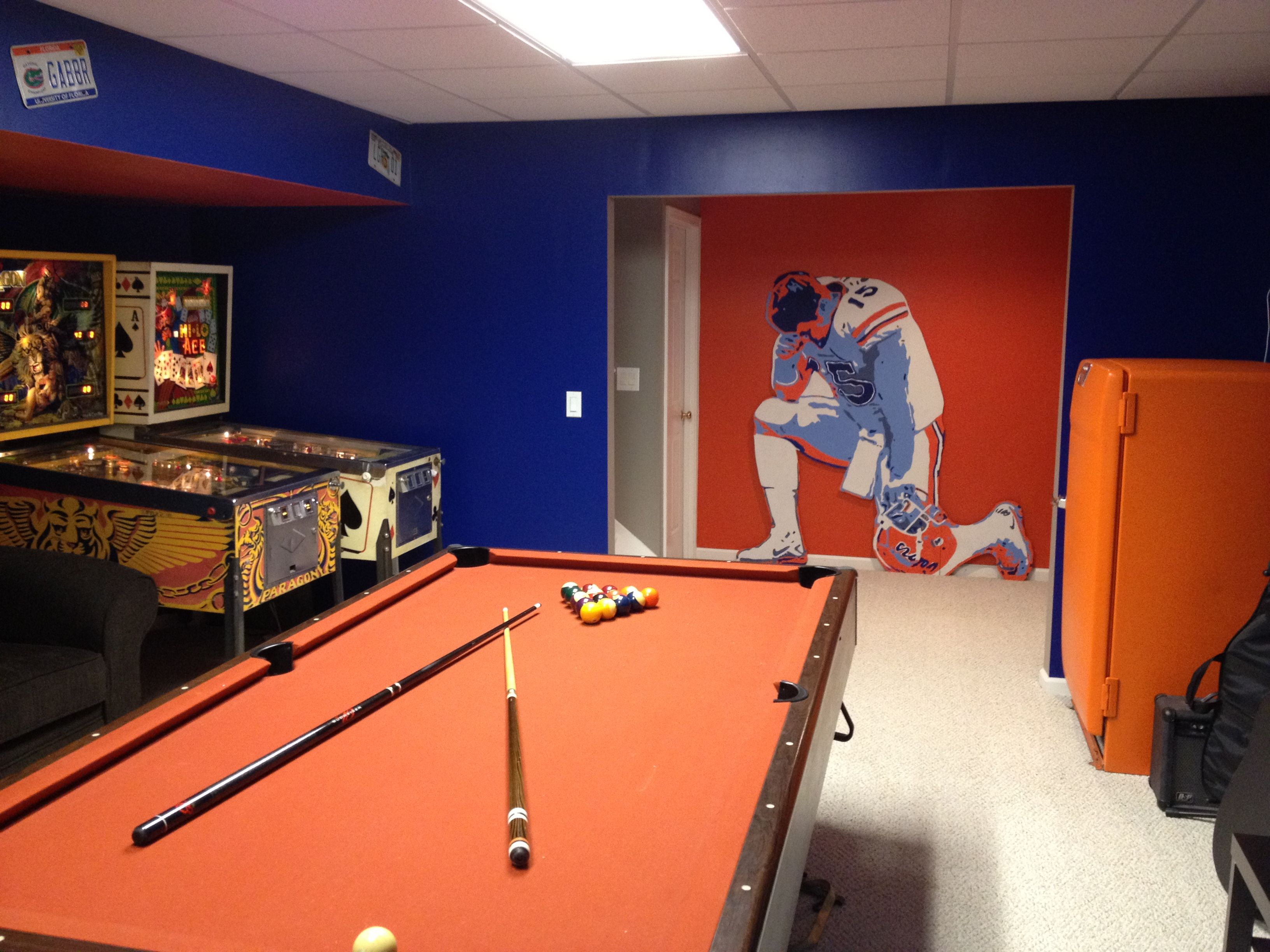 Florida Gator Themed, Complete With Pinball Machines, Pool Table, Retro  Beer Fridge, Bar, And Larger Than Life Tebow Tebowing Wall Art.