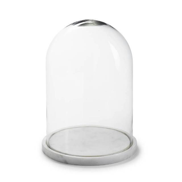 The Clear Detachable Glass Dome Of The Carrera Cloche With Marble