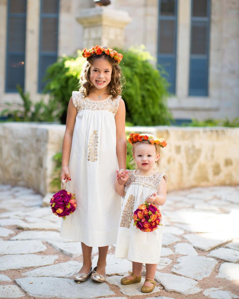 543d69e4749 Flower girls can never have enough florals. Fashion them in cute white  dresses with bright flower bouquets for playful pops of color.