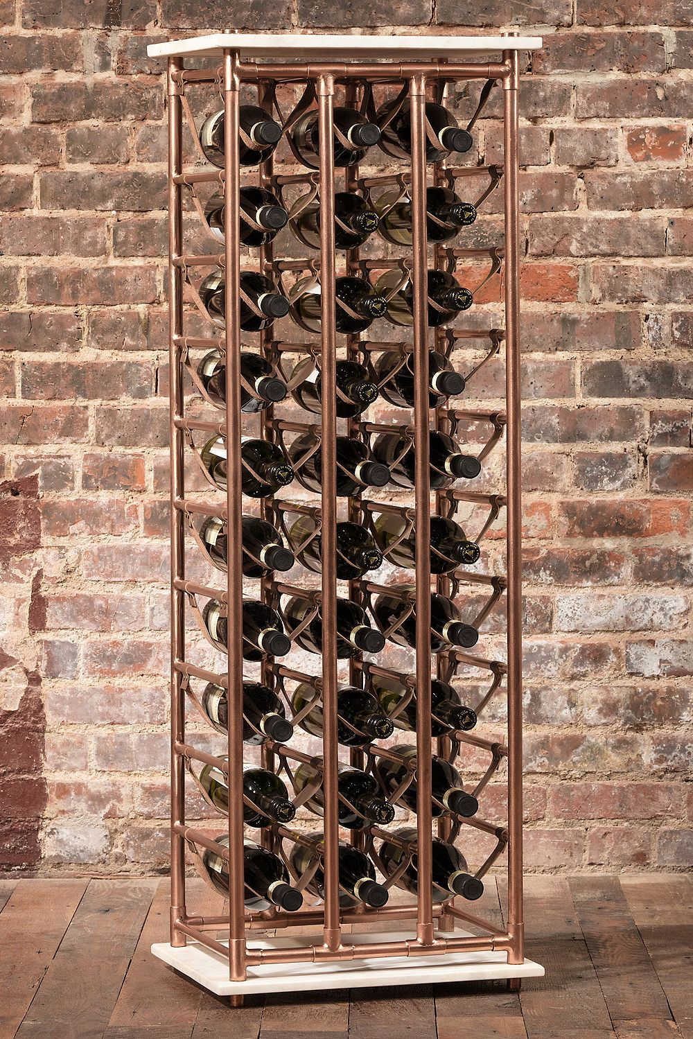 Genuine Leather Sleek Marble And Rose Gold Plating Effortlessly Combine To Create This Contemporary Wine Rack That S Up 30 Bottles